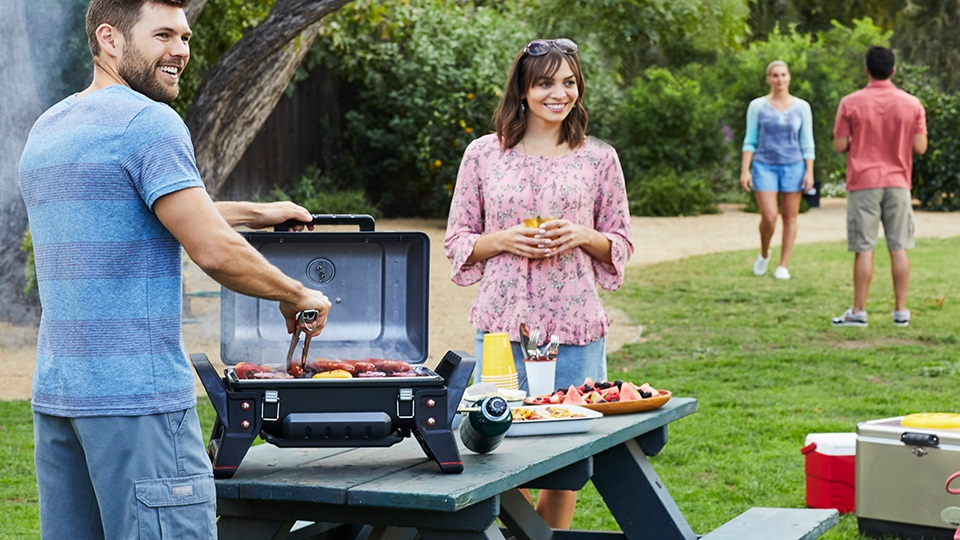 Grill2Go portable gas grill designed for camping, tailgating and grilling on the go.